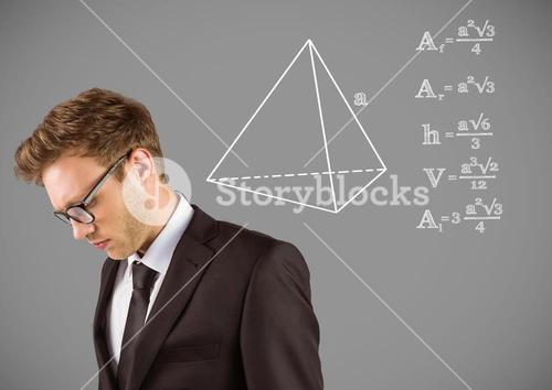 Businessman with equations drawing graphics