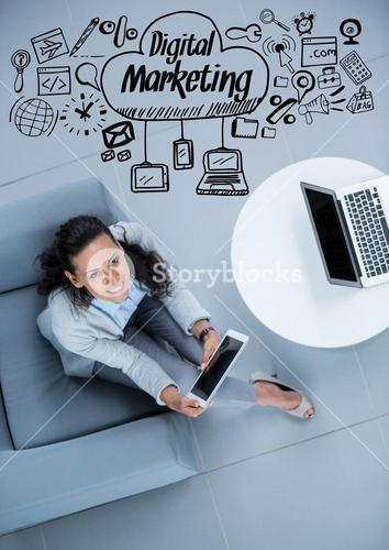 Overhead of business woman sitting with black business doodles