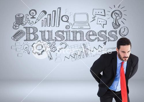 Businessman with business graphic drawings