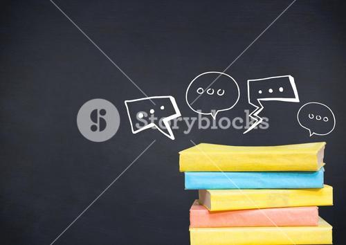 Pile of books with white speech bubbles against navy chalkboard