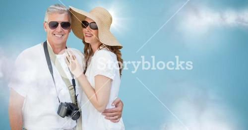 Couple summer clothes against blue background with clouds