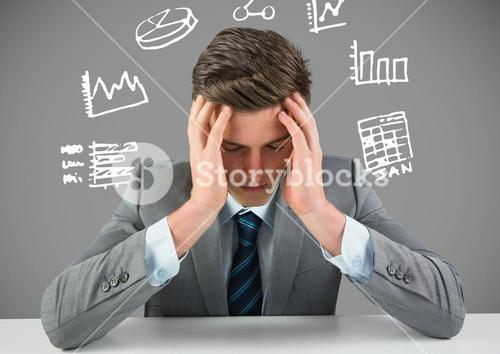 Businessman stressed with figures and charts drawings graphics
