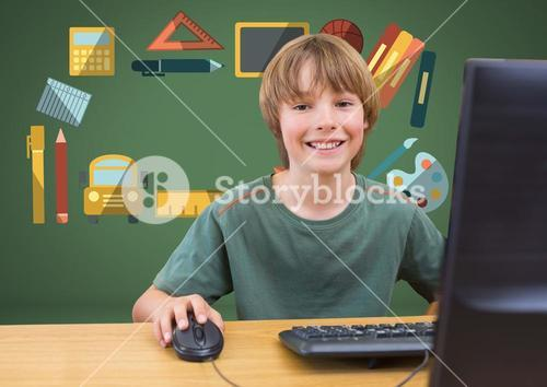 Young boy on computer with education graphic drawings