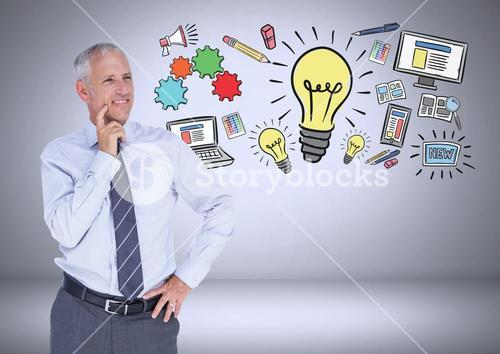 Businessman with ideas and computer graphic drawings