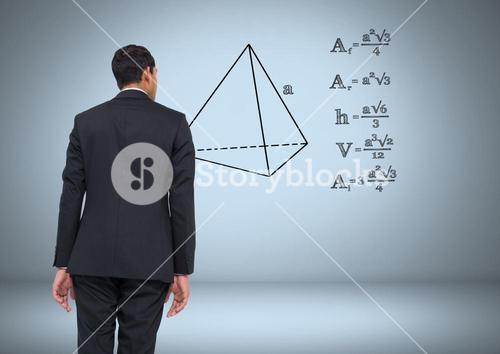 Businessman looking at equations graphic drawings