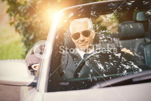Men driving a car