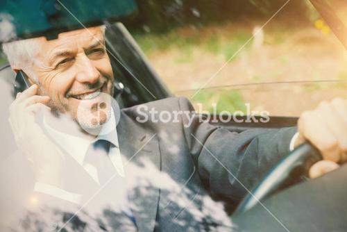 Men driving a car with his phone