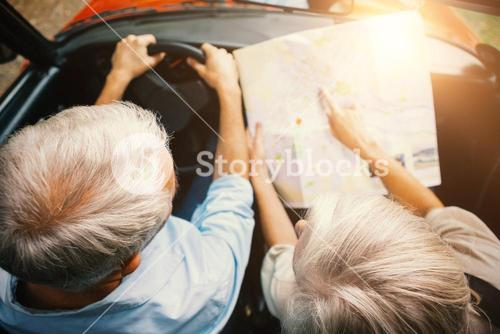 couple in a car looking at a road map