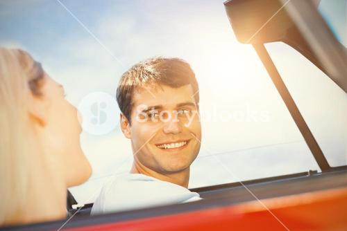 Couple in a car looking to each other