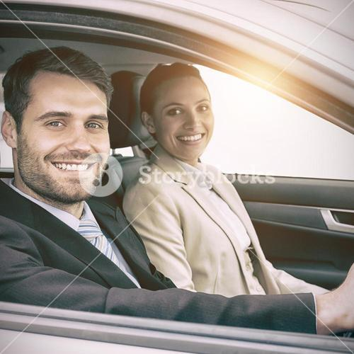 Couple in a car looking at the camera