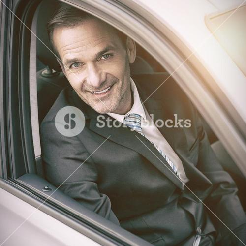 Man sitting in a car looking at camera
