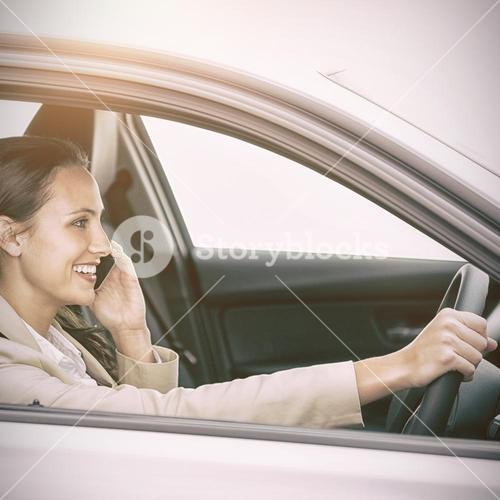 Woman driving and using her smartphone
