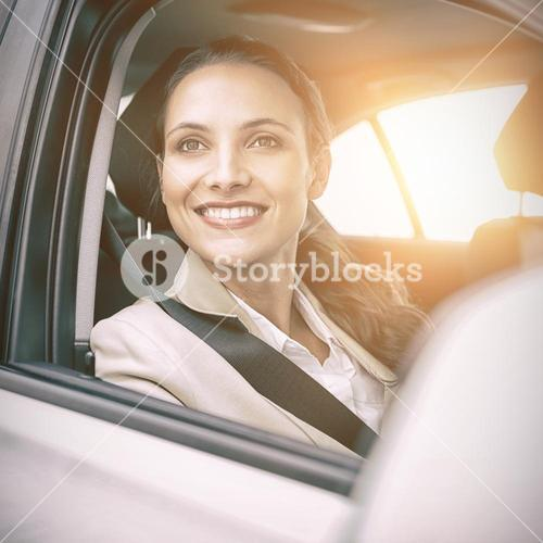 Woman sitting in a car and smiling