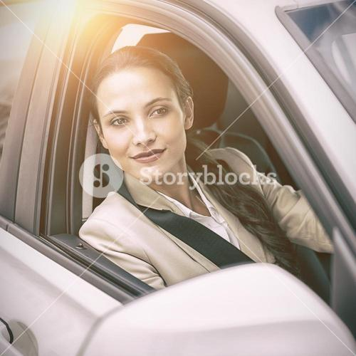Woman driving and looking away