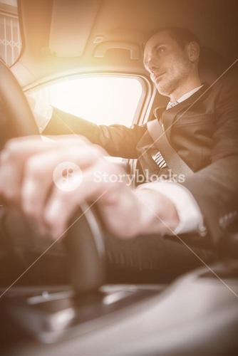Handsome businessman on drivers seat