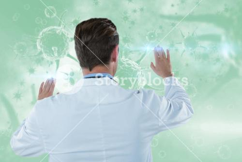 Composite image of rear view of doctor touching transparent interface 3d