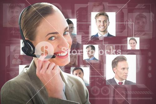 Composite image of smiling businesswoman with headset using computers