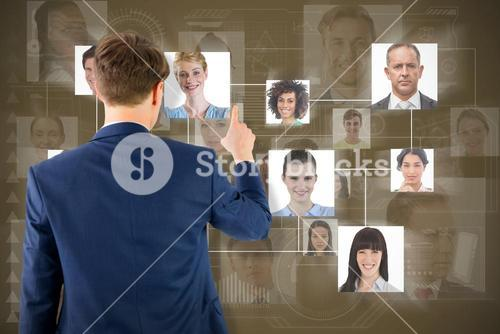 Composite image of businessman pointing something with his finger