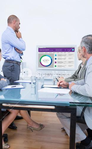 Composite image of business team looking at white screen