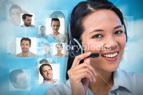 Composite image of smiling businesswoman using headset