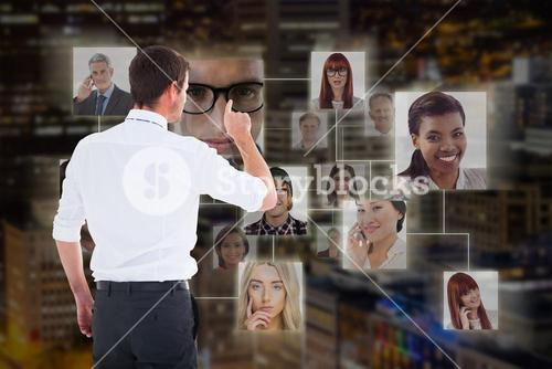 Composite image of handsome businessman pointing at a copy space