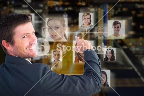 Composite image of businessman pointing with his finger
