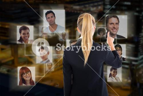 Composite image of business woman pointing somewhere