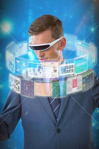 Composite image of businessman imagining while using virtual reality glasses 3d