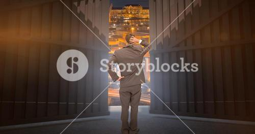 Composite image of young businessman standing back to camera scratching his head 3d