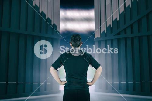 Composite image of back turned rugby player with hands on hips 3d