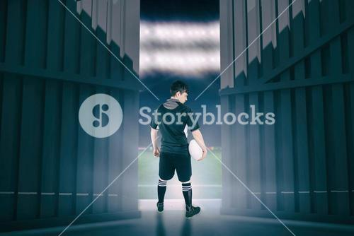 Composite image of back turned rugby player holding a ball 3d