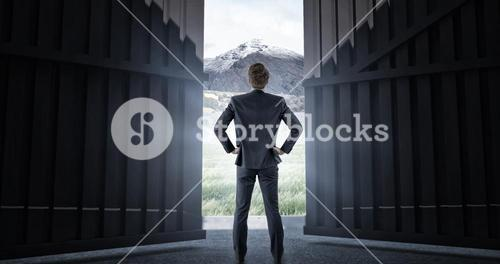 Composite image of wear view of businessman with hands on hip 3d