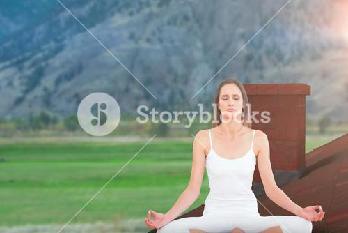 Composite image of toned woman in lotus pose at fitness studio