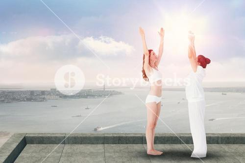 Composite image of relaxed women doing yoga