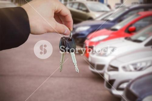 Composite image of woman smiling while receiving car keys