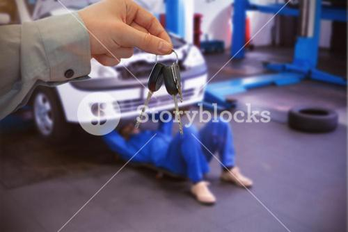Composite image of car dealer giving keys to a customer