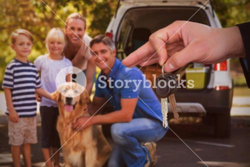 Composite image of happy woman receiving car keys
