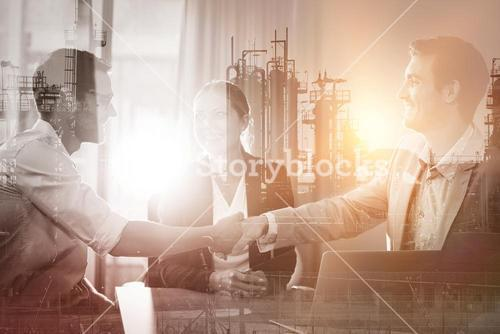 Business colleagues handshaking