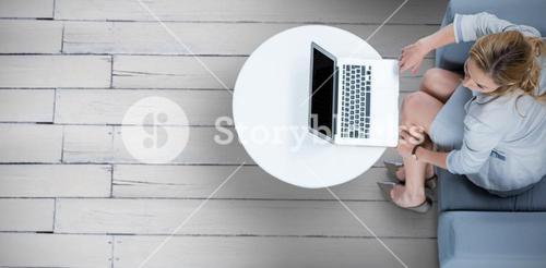 Composite image of woman on her laptop