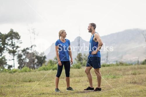 Fit people having a conversation