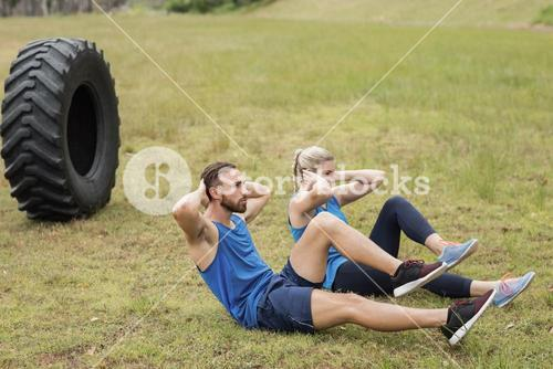 Fit people performing crunches exercise