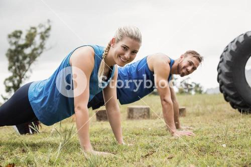 Fit people performing pushup exercise