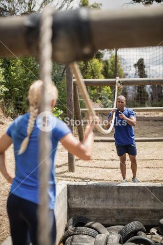 Fit man and woman practicing during obstacle course