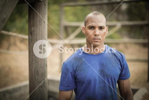 Portrait of determined man standing during obstacle course