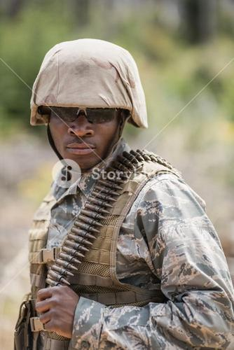 Military soldier standing with ammunition