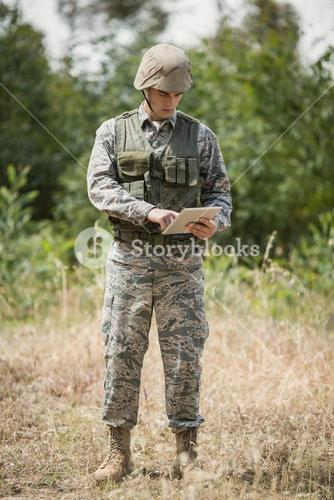 Military soldier using digital tablet