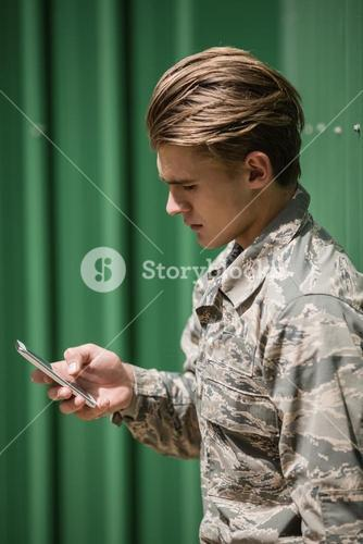 Military soldier using mobile phone