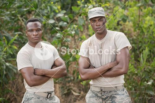 Military soldiers standing together during obstacle course