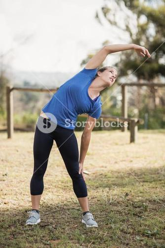 Fit woman exercising in boot camp
