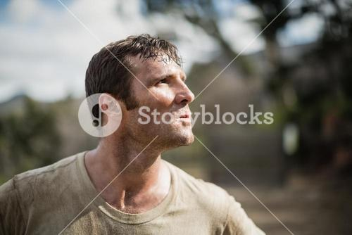 Military man standing during obstacle course
